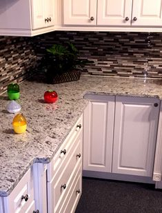 A kitchen renovation by B Wise Contractors featuring Quartz countertop, full wall tile backsplash, and White cabinets. Kitchen Reno, Kitchen Cabinets, Stone Countertops, White Cabinets, Wall Tiles, Backsplash, Flooring, Home Decor, Kitchen Cupboards