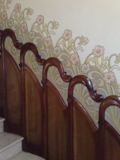 close up of art nouveau wall panneling details on stairs. arrimadero