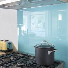 With a little research on the internet you can find detailed information about how to back-paint glass. Then if your skillful enough your result should be similar to this wonderful  ocean-blue , back-painted glass, perfect for a modern backsplash,
