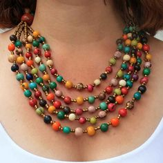 This vibrant bib necklace features five cascading rows of acai beads. A symphony of color, this Fair Trade necklace is inspired by the hues of