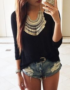 Causal black shirt and jeans shorts, but dressed up with that gold statement necklace.