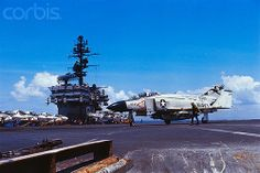 26 Apr 1972, Vietnam --- Off the Coast of Vietnam- The deck of the carrier is loaded with U.S. Navy jets. The aircraft carrier is located off the coast of Vietnam, southeast of Saigon. --- Image by © Bettmann/CORBIS.  #VietnamWarMemories