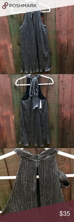 NWT Zara silver metallic tie neck dress New with tags never been worn Zara silver/black metallic dress. Larger slit at chest and smaller slit at back of neck. Dress buttons at neck and ties at back of neck for a classy look. No trades. Zara Dresses Mini