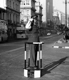 City Traffic Cop doing point duty at the intersection of Waterkant and Adderley streets.(this was usually done at peak-hour) Photo:Thanks to Alex Lawrence for the use. Old Pictures, Old Photos, Nordic Walking, Cape Town South Africa, Old Buildings, African History, Woodstock, Historical Photos, Old Houses