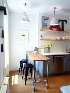 Narrow rolling cart like this perfect for kid kitchens -- extra prep space or dining area.