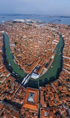 A different perspective of Venice as seen from the window of a plane! You can see the Rialto Bridge in the left foreground. The very large building to its right is the Fondaco dei Tedeschi (German Warehouse). In the upper right is the bridge for the train that comes to Venice.