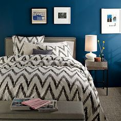 This bedroom is decorated in the reverse of most color schemes - the pop of color is in the teal wall paint, while the accessories are all neutral.  We paint homes in the #Bellingham WA area, and we can help you find the right color.  http://www.northpinepainting.com