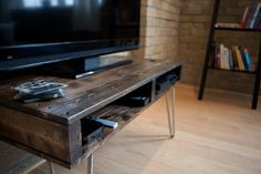 TV Stand / Hall Way Table / Slim Coffee Table made from hand selected Pallet Wood. $275.00, via Etsy.