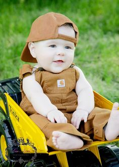 6 months @Lisa Phillips-Barton Nicole Photography .... Love the matching hat w/overalls and the tonka truck prop!!!! Note to self....