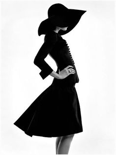 Black & white fashion photography with a striking silhouette - photoshoot ideas; model pose // Coco Chanel