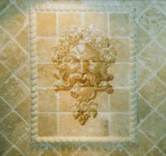 Head of Bacchus on tile. Painted with a custom paint kit by Franco.