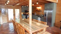 Farm style rustic custom #DIY table seats 12. Enjoy dinner with friends and family in #BlueMountainLodge  . #vacationrental #cabin #Gatlinburg