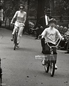 John Kennedy and Jackie Kennedy riding their bikes through Central Park………ccp