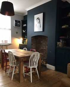 Hague Blue on just the chimney breast and bookshelves - white walls otherwise