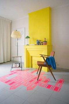 Create an eye-catching living room with a bright block of color.