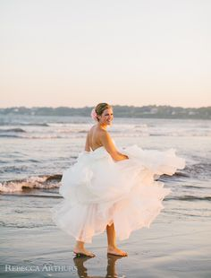 Lovely photograph of a bride on the beach.