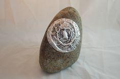 Aluminum and wax backed with beeswax on rock. Owl Mandala
