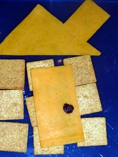 House shaped snack made with cheese and crackers and raisin