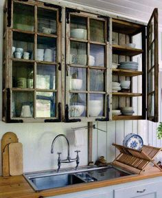 Rustic kitchen with old windows used as cupboard doors... nice! #MyVeganJournal