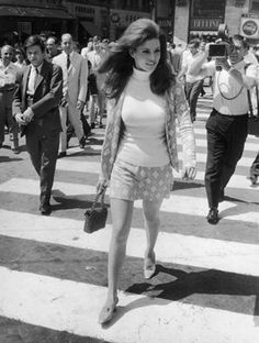 Raquel Welch in Piazza di Spagna, Rome followed by photographers. Photo by Keystone/Getty Images.