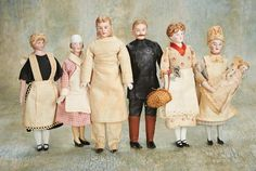 "Small Courtesies: 175 Six German Bisque Dollhouse Dolls in Service Outfits  6"" (15 cm.) -7"". Each has bisque shoulder head with sculpted hair,painted features,muslin body,bisque lower limbs,painted shoes,and each is wearing its factory-original costume to represent its position in the household. Condition: generally excellent. Comments: Germany,circa 1900. Value Points: included are chef with modeled sideburns,parlor maid with brown hair and high white stockings,chauffeur with moustache and…"