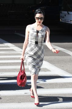 Dita von Teese in plaid and red...