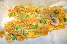 a beautiful foodporn photo of a  delicious omelette that I food smashed. made with no cheese LOL but with mushrooms, green peppers, onions, tomatoes and doused with pepper. yummy 😋