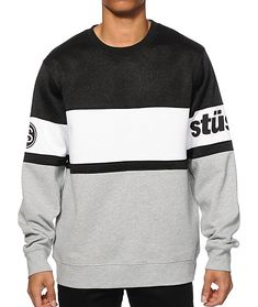 Stay comfortable with a soft fleece lining on a color blocked black, white, and grey design with Stussy logo graphics on the sleeves.