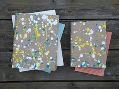 Paint splatter book cover. What a great outdoor craft for the summer! Save the mess in the house. Kids can create their own summer journals. These would make sweet gifts, too.