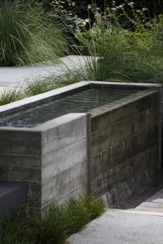 "A closer look at the lower fountain, made of board-formed concrete wtih no finish on the interior. ""It was meant to be simple,"" says Tessier."