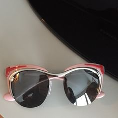 Prada cat eye sunglasses Pink, red and metallic real Prada sunglasses. I lost the case but I have a Marc Jacobs one that fit them perfectly. Prada Accessories Sunglasses