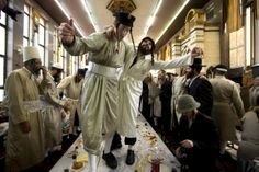 Ultra-Orthodox Jewish men in costumes dance at a yeshiva, a rabbinical seminary, during Purim celebrations in Jerusalem. The festival of Purim commemorates the rescue of Jews from genocide in ancient Persia recorded in the Biblical Book of Esther.