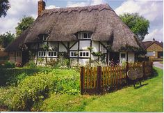 Woodley Cottage, Echinswell. Chocolate box village view of a 17th century thatched cottage