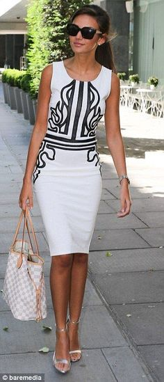 Smooth ponytail with a pair of large black shades, White and black dress.