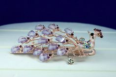 This hair clips lilac stones and rose gold painted brass capture light beautifully and make it an attention-grabbing hair accessory. Perfect for