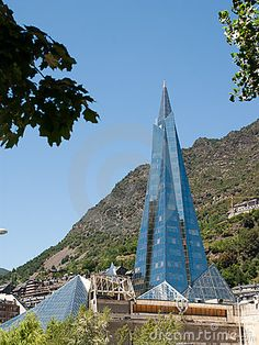 The pyramid in Andorra la Vella by Yoav Sinai, via Dreamstime. High-tech pyramid of Andorra. Another shot from the glass pyramid-building in Andorra. Andorra is a tiny country squeezed in between Spain and France. This was shot in the village Escaldes-Engordany which most people would consider part of the Capital Andorra la Vella.