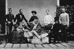 Standing (left to right): Emperor Franz Josef, Archduke Maximilian, Archduchess Charlotte (Carlota), Archduke Ludwig Victor and Archduke Karl Ludwig. Seated (left to right): Empress Elizabeth with Crown prince Rudolf, Archduchess Gisela, Dowager Duchess Sophie and Archduke Franz Karl.