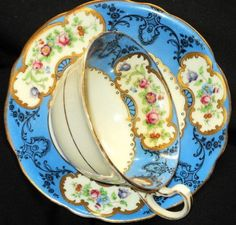 ANTIQUE AYNSLEY BLUE GOLD BIRD TEA CUP AND SAUCER