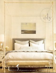 Serene..the tiny detailed frame of the four poster, the landscape and muted tones of bedding. Oly