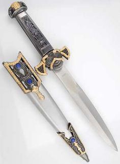 This ritual athame has a design derived from a blend of styling from medieval Europe and the ancient Celts. With elaborate scroll work decorating its hilt and sheath, it offers a blend of silver and gold-toned decoration throughout, accented by blue, faceted stones that are set within the sheath and crossguard.  The crossguard, together with the pommel, flares upward in a fashion that blends decorative styling with comfort, allowing the athame`s haft to fit easily into your hand even a $44.95