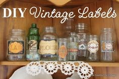 DIY Vintage Labels - these are simple - printed on BoBunny paper - i NEED some of that paper! (Saw a set of cans earlier today that were around 40 dollars for a set - how crazy is that? These look great, and all for the price of a single sheet of paper and a dab of mod podge!)