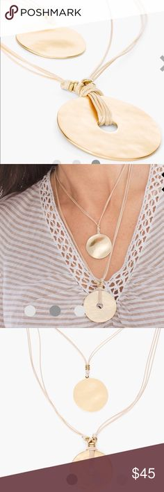 🎉It's a Go-Go Drop Statement Necklace 🎉This relaxed and refined necklace is a perfect icee for s casual day look it or a night on the town. Double strands of ivory leather strands suspend 2 modern medallions to provide a sleek design. Jewelry Necklaces