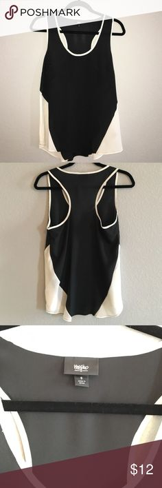 Black with cream panels racerback polyester tank Looks brand new! It is size small but I personally think it is more of a size medium. It would be flowy and cute on a size small person though.  Fabric is light and airy. The black is not completely sheer but you would definitely need to wear something underneath it. Mossimo Supply Co Tops Tank Tops