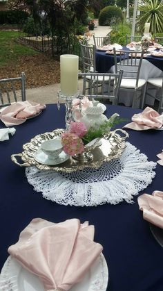 Vintage tea set centerpiece. Vintage China. Marine wedding. Military wedding. Outside wedding.