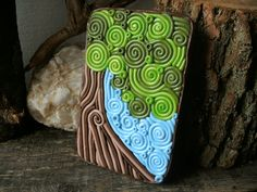 "Tree Cigarette Case Wallet OOAK ""Tree Hugger"" Metal Tin Hand-Decorated with Polymer Clay. $60.00, via Etsy."