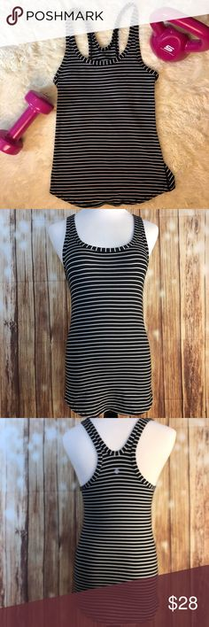 """Lululemon Black & White Stripe Athletic Tank Top Preowned Lululemon Black & White striped tank top. Fitted, but stretchy. There is no tag or size dot, but my guess is a fitted size 4. I'm a size 6 in Lulu & this is too tight for me! 😫 The mannequin is a size 2, for reference. Armpit to armpit is 13.5"""" & length is 25"""".  {This listing is for the hoodie only. 💖}  Smoke-free home, but cat friendly. 🐱 No trades, try-ons, or off Posh sales. Please see pics. Feel free to ask questions. Thank…"""