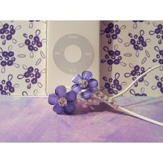 Cute Purple frosted petal flower earbuds with swarovski crystals ($15) ❤ liked on Polyvore featuring accessories, tech accessories, earphones earbuds, ipod earbuds, iphone earbuds and apple iphone earbuds