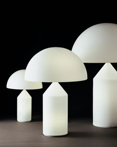 Awarded the Compasso d'Oro in The opal glass Atollo table lamp, is truly a work of art. The top section contains two lamps and the base cylinder a separate lamp. Available in three sizes. Bedside Reading Lamps, Bedside Lamp, Nightstand, Modern Lighting, Lighting Design, Atollo Lamp, Berlin Design, Led Desk Lamp, Table Lamps