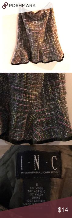 Wool Skirt Multi colored knee length wool skirt. With minor signs of wear. Fit and flare fit. Rubber Ducky Productions, Inc. Skirts Midi