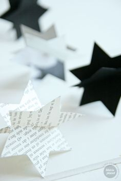 Create three dimensional stars for your Hanukkah table. Just die cut identical sized stars from whatever lovely paper strikes your fancy (needs to be stiff paper, but you can layer thinner paper onto cardboard or cardstock) Cut a slit half way through each and slide two together. Done!
